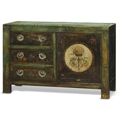 Hand Painted Tibetan Chest.  Exuberant and bold, the artwork on this cabinet displays the liveliness of Tibetan art. The one of a kind design provides a great addition to any household. The distressed finish and hand painted darker floral designs give it a charming character and a unique personality. Tibetan furniture.