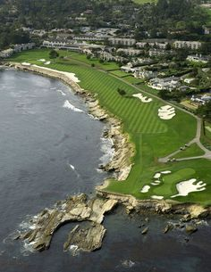 The 18th hole at Pebble Beach Golf Club is a dogleg left par 5 that hugs the Pacific Ocean the entire length.