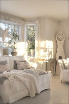A beautiful, relaxing white living room for snuggling to read a book or magazine or watching a movie.