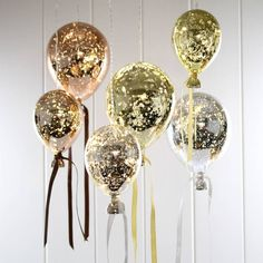 Amazing hanging mirrored metallic balloon lights. Illuminate a corner of the room or create a feature cluster of hanging light bulbs- filled with fairy lights!Perfect to style above wedding tables, at parties or for any room in the house that needs lighting up.These gorgeous hanging mirrored balloon lights are amazing! Create a statement with these wonderful lights. During the day they work as an interesting feature within the room, at night they have a warm atmospheric glow and reflect the…