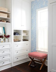 White and blue walk-in closet features white built-in cabinets fitted with modular shoe and sweater shelves, Closet with stacked white shelves placed over a mirror and a built-in dresser. Linen Closet Shelves, Linen Closet, Interior, Home, Built Ins, Shingle Style Homes, Closet Built Ins, Interior Design, Closet Design