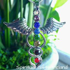 Angel Wings Chakra Pendant - Spiritual Gifts Ireland  Angels are divine messengers sent to help us on our Spiritual journey, they are gifts from God.  Don't be afraid to ask for even the smallest favour.  Often it is the little stresses that grow to major issues.  Our Angelic friends help to restore your happiness, health, peace and abundance. Anyone can tune in to their messages.  You were created in divine light and deserve love and miraculous blessings.  Our Angel Wings Pendant has the 7…