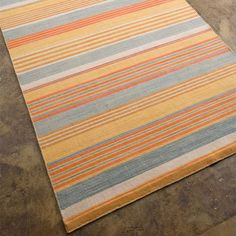 I pinned this Beacon Stripe Rug in Saffron from the Coastal Living Rugs event at Joss and Main!