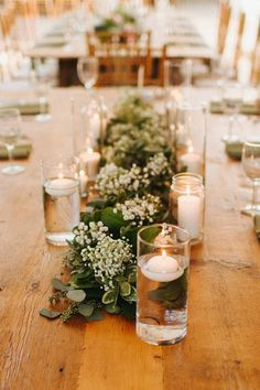 Floating candles and lush greenery runners with babies breath / http://www.himisspuff.com/rustic-babys-breath-wedding-ideas/