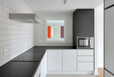 DRDH and adVVT complete elderly home in Belgium featuring simple materials and bold splashes of colour.