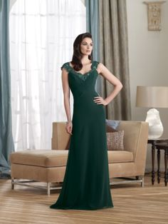 Lace and chiffon A-line dress with scalloped lace shoulder straps and sweetheart neckline, ruched crisscross bodice with inverted Basque waistline, sheer lace back bodice with low cowl drape, sweep train. Matching shawl included. Sizes: 4 – 20