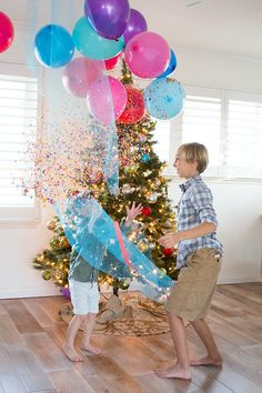 Family New Year's Eve Idea: DIY Balloon Drop  Add games in the balloons. Pop a balloon to reveal a task or activity...