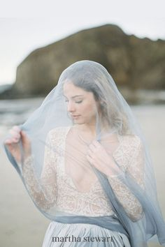 "Looking for a contemporary way to translate the ""something blue"" big-day tradition? Consider a dusty-blue veil, like this gauzy, moody option. #weddingideas #wedding #marthstewartwedding #weddingplanning #weddingchecklist Wedding Veils With Hair Down, Hair Wedding, Wedding Groom, Wedding Bands, Chapel Length Veil, Bride Veil, Vintage Veils, Dusty Blue Weddings, Blue Wedding Dresses"