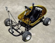 Kids wagon made out of an old wheel baro
