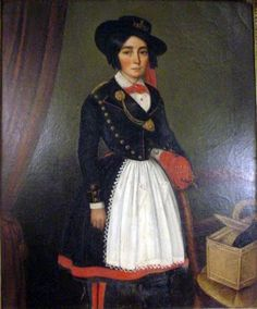 """So Tom Holberg, in a short article on cantinieres at   http://www.napoleon-series.org/military/organization/c_cantinieres.html refers to cantinieres as having been issued medallions or badges indicated their position. Is that what this is on her tonnelet strap? In this picture, it looks almost like she's got the little bomb on her medallion, like the one on the antique piece. Hmmmm… more research necessary.  pic from blog """"I like what I like"""""""