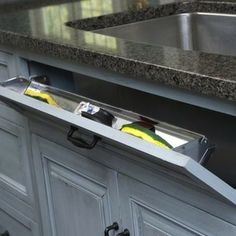 Let It Sink In    If you thought putting the toe kick to good use was clever, you'll love this tilt-out sink drawer from Mullet Cabinet. Designed to store and hide sponges, gloves, scrub brushes and other cleaning supplies, the drawer takes advantage of dead space between thee sink's outer wall and the cabinet's exterior.