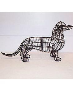 Wondering if this would completely freak my dogs out? Might be worth a try - so cute! Dachshund Topiary Frame