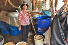 Worker Mixes Tiny Fish With Ingredients That Make Cambodia's Pungent Fish Sauce