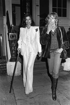 Bianca Jagger in YSL's insanely chic white Le Smoking, with French model Nathalie Delon.