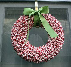 """with a little help from the cheap candy aisle at the drug store   * these are really simple to do. all you need is a glue gun, a foam wreath and hands made of asbestos. i think one made of lemon drops would be so adorable!  --the peppermint wreath is 12"""" with a flat back. it took approximately 2 1/2 bags (1lb 9oz each) of Bob's Sweet Stripes. The back is not covered. i do hope you make one!"""