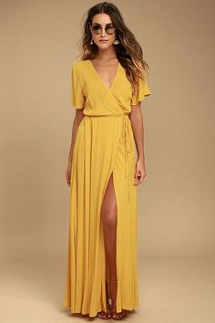 We're forever grateful we found the Much Obliged Golden Yellow Wrap Maxi Dress! Gauzy woven rayon drapes into a sultry surplice bodice, framed by fluttering short sleeves. Wrapping maxi skirt secures via hidden, internal ties and an adjustable waist tie.