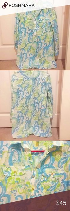 Lilly Pulitzer Blouse EUC blouse from LP. Blue white green and yellow color floral pattern. V neck with gold button down buttons.two pockets on the front. All cotton Lilly Pulitzer Tops Blouses