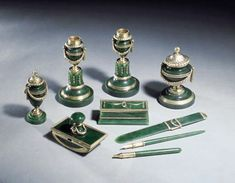 A silver-gilt mounted nephrite desk-set marked Fabergé, workmaster Henrik Wigström, St. Petersburg, 1896-1908, with scratched inventory number 16744, fully marked, the pen and pencil with inventory number The candlesticks 6in. (15cm.) high