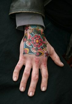 Check out this sweet #Traditional #Anchor and #Flower #HandTattoo by Marcus Kuhn #Tattoos #tattoo #InkedMagazine #Inked #InkedMag
