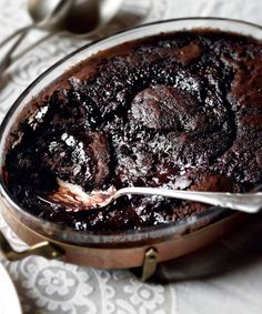 This dessert is a chocoholic's dream. The double chocolate pudding recipe from Joanne Harris is made up of a light chocolate sponge and a rich chocolate sauce. Köstliche Desserts, Delicious Desserts, Dessert Recipes, Yummy Food, Pudding Desserts, Chocolate Pudding Recipes, Chocolate Desserts, Chocolates, Eat Dessert First