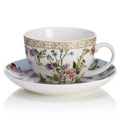 V - Conjunto de taza de té, plato y platillo