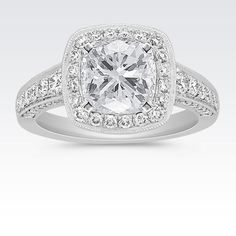 Halo Diamond Engagement Ring with Pavé Setting with Cushion Cut Diamond from Shane Co. Available with your choice of ruby, diamond or sapphire center stone.