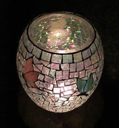 MAKING MOSAICS With my mosaics I mainly use traditional stained glass that I buy in large sheets and then handcut into tiny little pieces. ...