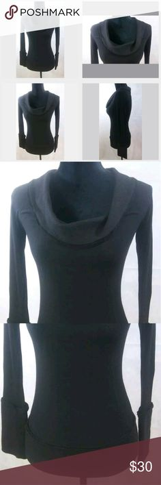 """Donna Karen Black Long Sleeve Womens Top item does have a pinhole size hole on the shoulder which is pictured. This blouse is trimmed with 100% wool on the bottom of the shirt the neckline of the shirt and the sleeves. The body of the shirt is made with Viscose wool and spandex.  Approximate Measurements:  Pit to Pit: 25""""*  Shoulder to shoulder: n/a""""  Length: 23""""  Sleeve Length: 23""""  *doubled  Items are measured laying flat Donna Karen Tops Tees - Long Sleeve"""