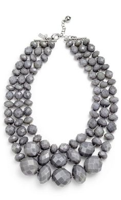 And more grey with a great chunky necklace as statement piece