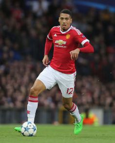 MANCHESTER, ENGLAND - AUGUST 18:  Chris Smalling of Manchester United in action during the UEFA Champions League play-off first leg match between Manchester United and Club Brugge at Old Trafford on August 18, 2015 in Manchester, England.  (Photo by Tom Purslow/Man Utd via Getty Images)