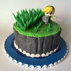 Link enjoying cutting grass along his epic journey ! ~ 1 tier : round pan, tier composed by : 4 layers of Vanilla cake ~ Chocolate peanut butter cream frosting ~ Link Topper made of fondant and. Fondant Cakes, Cupcake Cakes, Nintendo Cake, Zelda Cake, Zelda Birthday, Legend Of Zelda, Fantasy Cake, Chocolate Peanuts, Cake Chocolate