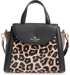 Adding a fierce touch to any ensemble with this compact satchel fashioned from supple pebbled leather accented with leopard-print genuine calf hair. Dual top handles and an optional crossbody strap offer styling versatility, while gilded hardware polishes the look of this Kate Spade beauty.