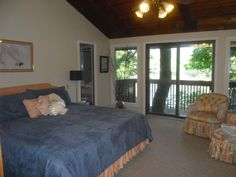 Master bedroom- shows the upper deck outside master, overlooking Lake Austin