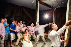Everybody goes for the garder in this Charleston Beach wedding. The look on the bride's face is great!