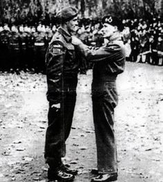 Major Charles Dalton, Queen's Own Rifles of Canada, receiving the DSO from General Montgomery