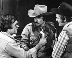 Director Hal Needham, Burt Reynolds, and Jerry Reed on the set of Smokey and the Bandit (1977)