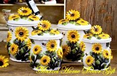 """Country Sunflower 4PC CANISTER Ceramic Kitchen Decor by Marcel Imports. $46.00. Welcome To Marcel Home Decor & GiftMake a stunning addition to any kitchen decor. This beautiful set of canister will add a fresh country style to your decor.- Handcrafted and hand-painted of ceramic.- Sunflowers pattern- Dishwasher safe- Plastic Seal Lids to keep ingredients fresh.- Materila: Glassed Ceramic.- Measurements ApproximatelyXLarge: 11 3/8""""HLarge: 11""""HMedium: 9 1/2""""HSmall: 8 5/8""""H"""