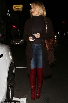 Thigh's the limit! She amped up the sex appeal as she showcased her long legs in red leather thigh-high boots and skintight indigo jeans on Thursday night