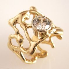 rund ring in gold with a white sapphire by dougpetersonjewelers, $680.00