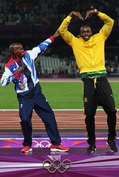 Jamaica's Usain Bolt and Great Britain's Mohamed Farah imitate each other after the athletics in the Olympic Stadium at the 2012 Summer Olympics, London, Saturday, Aug. 11, 2012. (AP Photo/Matt Slocum)