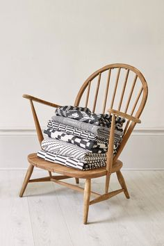 Woven throws on a vintage Ercol chair. Photographed by Yeshen Venema. Ercol Chair, Weaving Textiles, Jacquard Weave, Bassinet, Accent Chairs, Cushions, Vintage, Furniture, Design