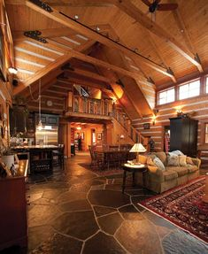 log home open kitchen dining living spaces | ... and overlooking the open great room adds visual appeal to the space