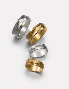 """Ladies and Gents wedding Bands"" by Wayne Victor Meeten. Hand Hammer fluted  Platinium, 18 carat White Gold, Palladium. Silver & 18 carat, 22 carat, 24 carat Yellow Gold."