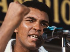 Muhammad Ali gestures at a press conference prior to his fight with Larry Holmes at Caesar's Palace, Las Vegas, Oct. Ali decided to end his retirement and face Holmes, his old sparring. Michael Parkinson, Larry Holmes, Muhammad Ali Boxing, Hometown Heroes, American Comics, American History, Throw In The Towel, Sport Icon, Sport