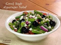 14 Perfect Picnic Dishes including this Greek Style Asparagus Salad- Lots of great recipes to plan for a picnic!