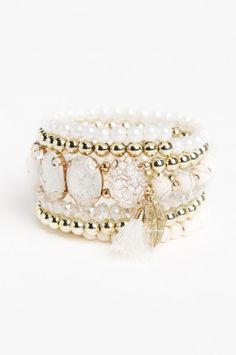 Ardene's bracelets are adorned with faux pearls and gemstones. Shop for bangles, anklets, and ME to WE Rafiki bracelets for a good cause. Pearl Bracelet, Anklets, Spiral, Wedding Rings, Engagement Rings, Gemstones, Pearls, Bracelets, Jewelry
