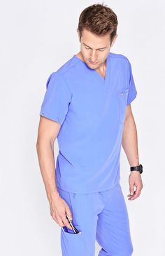 Double pocket men's performance scrub top with a modern, streamlined look. Four-way stretch and moisture-wicking fabric keep you comfortable. Nursing Supplies, Medical Uniforms, Men In Uniform, Scrub Tops, Glamour, Scrubs, Polo Ralph Lauren, Men Casual, Mens Fashion