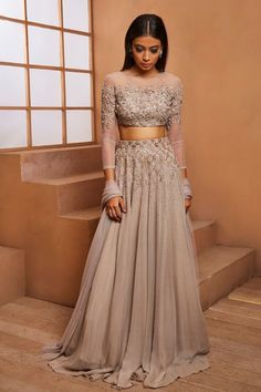 Grey embellished full sleeve blouse with self embellished grey lehenga and plain net dupatta. *This piece includes 3 - 4 inch Dress Indian Style, Indian Fashion Dresses, Indian Designer Outfits, Indian Prom Dresses, Indian Designers, Indian Fashion Trends, Indian Blouse, Bridesmaid Dresses, Mode Bollywood