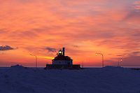 """""""Winter Sunrise""""<br /> <br /> The vibrant sunrise creates a fitting backdrop for Canal Park's South Pier lighthouse in Duluth on another frigid winter morning."""