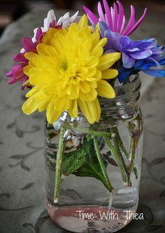 A very simple rainbow bouquet in a small mason jar.